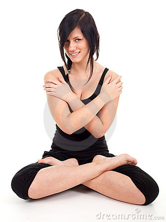 Young woman doing yoga exercise in lotus pose