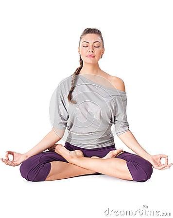 young woman doing yoga exercise padmasana lotus pose