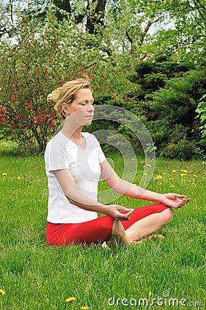 Young woman doing yoga - meditation