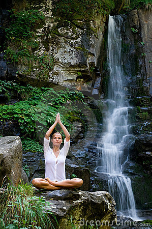 Young woman doing yoga in the nature