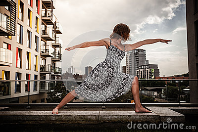 Young woman doing yoga on roof top