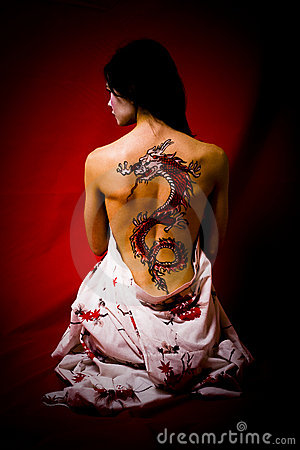 Young woman with dragon tattoo Editorial Photography