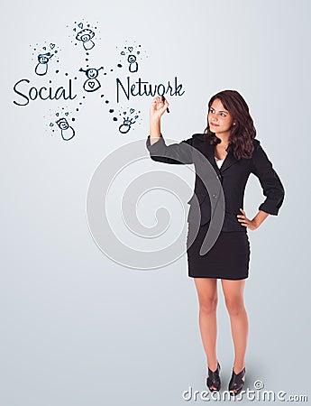 Woman draving social network theme on whiteboard