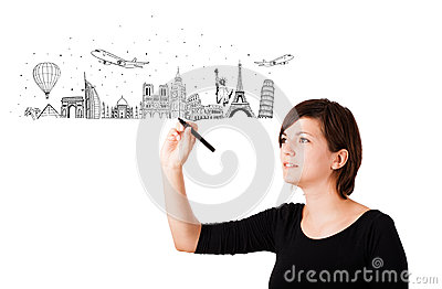 Young woman drawing landmarks on whiteboard
