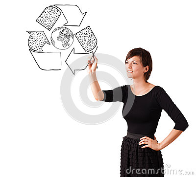 Young woman drawing recycle globe on whiteboard