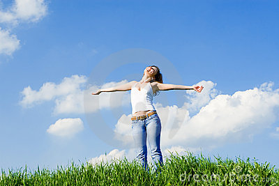 Young woman dreams to fly on winds