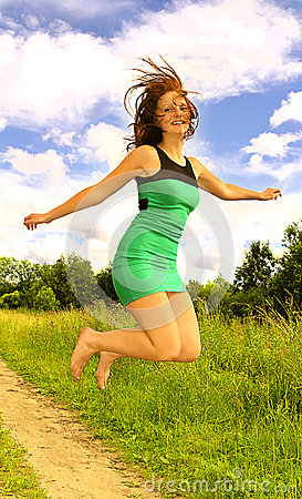 Young Woman in dress Jumping Up