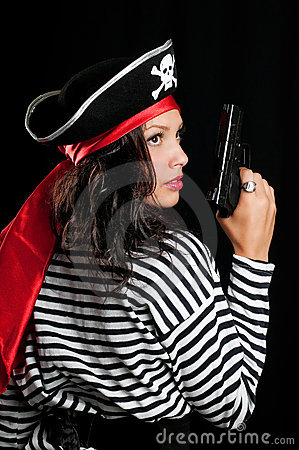 Young woman dressed as a pirate in a black hat hol