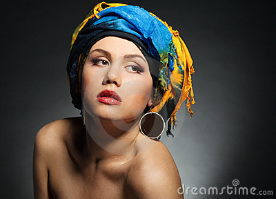 A young woman dressed in a turban
