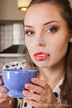 Young woman drink coffee at home