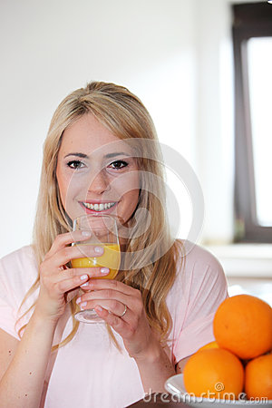 Young woman drinking fresh orange juice
