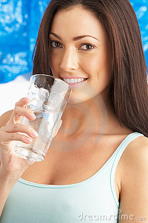 Free Young Woman Drinking Glass Of Water In Studio Stock Photography - 14457072