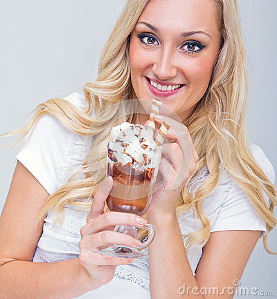 Young woman drinking ice coffee