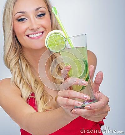 Young woman drinking lemonade
