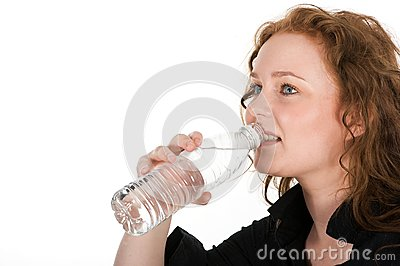 Young woman drinking mineral water