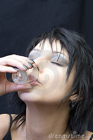 Young woman drinking a shot