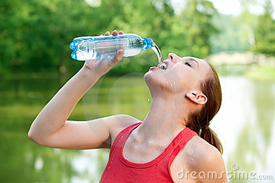 Young woman drinks a water
