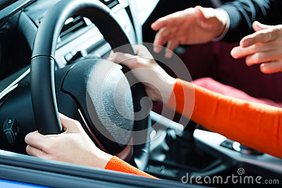 Young woman at driving lesson
