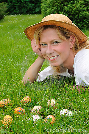 Young woman and easter eggs on the grass - Easter
