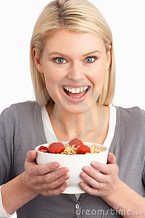 Free Young Woman Eating Bowl Of Healthy Breakfast Royalty Free Stock Images - 14451869
