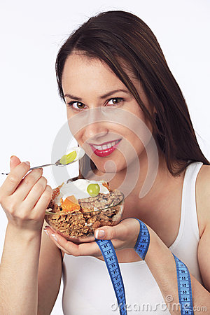 Young woman eating breakfast cereals