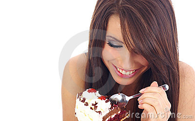 Young woman eating the cake.