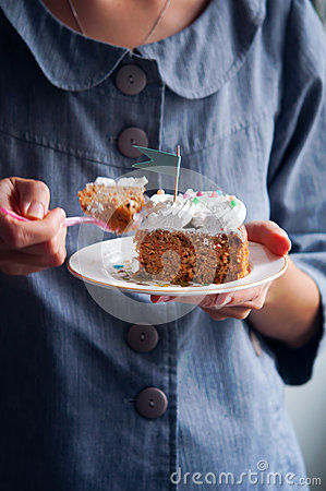 Young woman eating carrot cake
