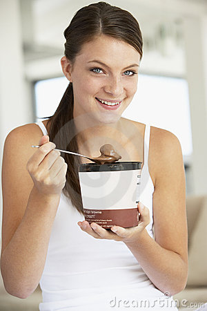 Free Young Woman Eating Chocolate Ice-Cream Stock Photo - 7874280