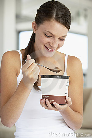 Young Woman Eating Chocolate Ice-Cream Royalty Free Stock Photo - Image: 7874285