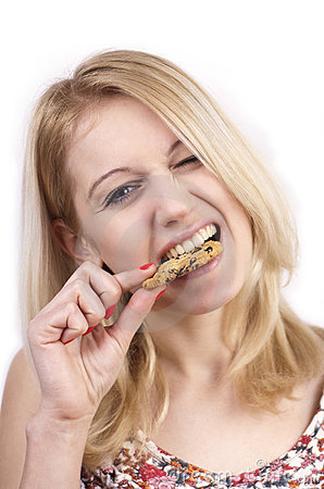 Free Young Woman Eating Cookie With Grimace Stock Image - 23260481