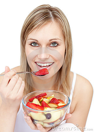 Young woman eating a fruit salad