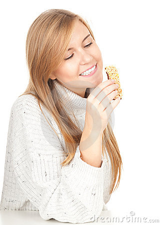 Young woman eating granola bar