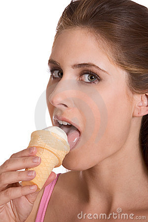 Young woman eating ice cream in waffle cone