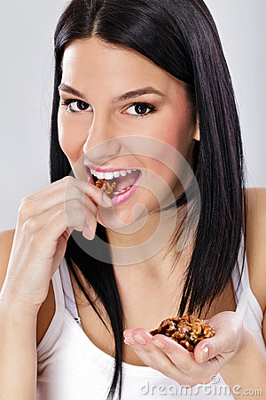 Free Young Woman Eating Nut Stock Photo - 26438480