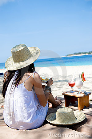 Free Young Woman Eating On The Beach Stock Photography - 6649972