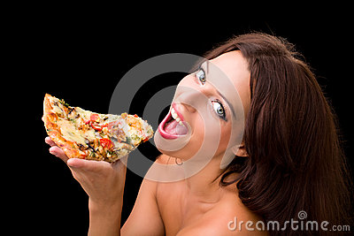 Young woman eating a piece of pizza