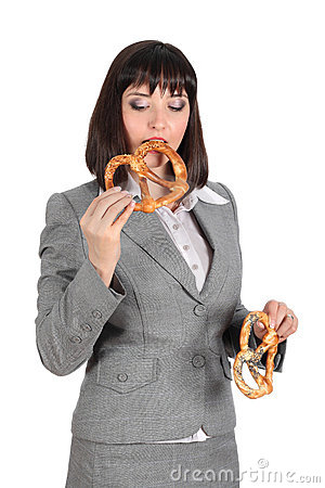 Young woman eating a pretzel