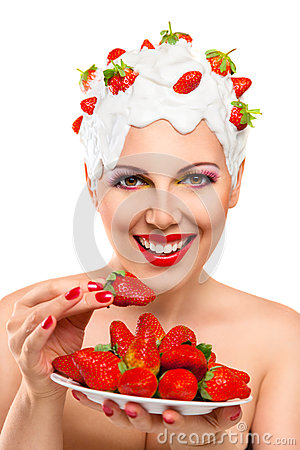 Young woman eating red ripe