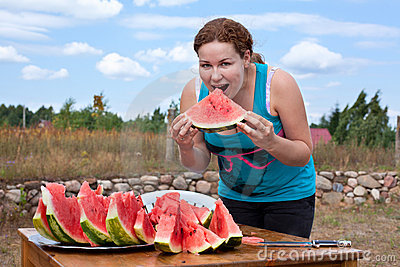 Young woman eating watermelon.
