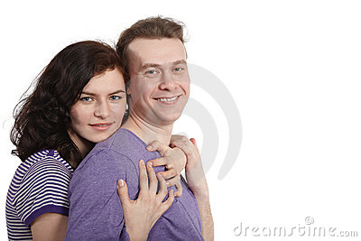 Young woman embraces a young man from behind. Stock Photo