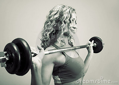 A Young Woman Is Engaged In Weightlifting Stock Photography - Image: 13143502