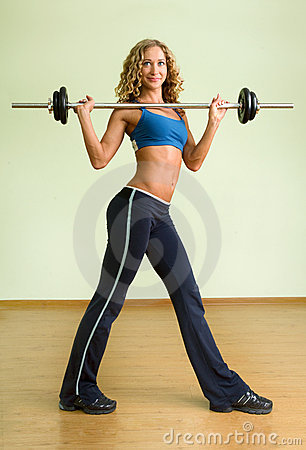 A young woman is engaged in weightlifting