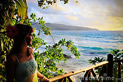 Young woman enjoying beautiful tropical sunset