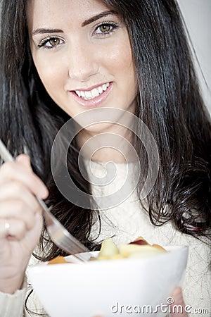 Young woman enjoying breakfast