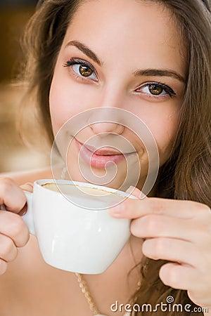 Young woman enjoying coffee.
