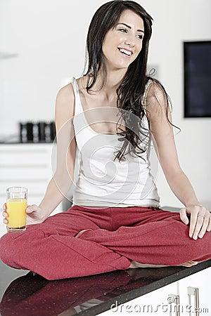 Young woman enjoying a glass of juice