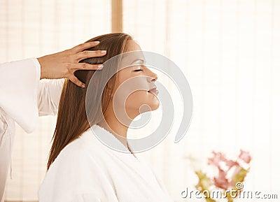 Young woman enjoying head massage