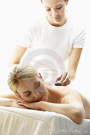 Young Woman Enjoying Hot Stone Treatment