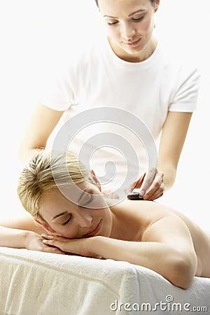 Young Woman Enjoying Hot Stone Treatment