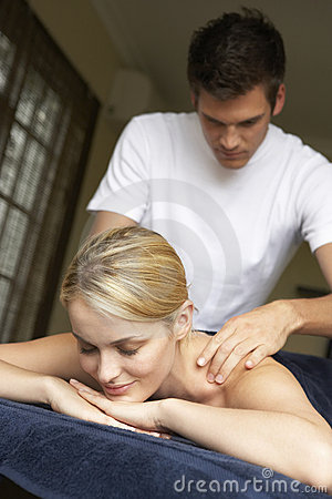 Young Woman Enjoying Massage